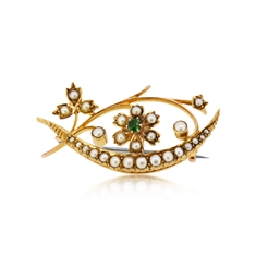 A Victorian Garnet & Seed Pearl Floral Crescent Brooch