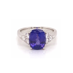 Oval Tanzanite Dress Ring With Trefoil Diamond Shoulders