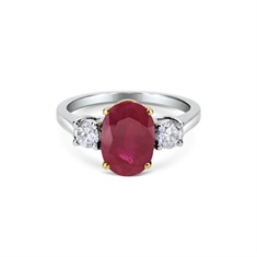 Oval Ruby & Brilliant Cut Diamond Claw Set Three Stone