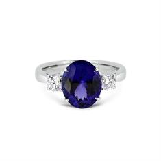 Tanzanite Oval & Diamond Claw Set Three Stone