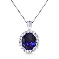 Oval Tanzanite Cluster Pendant With Tapered Baguette Diamond Bail