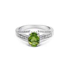 Oval Peridot Single Stone Brilliant Cut Diamond Shoulders