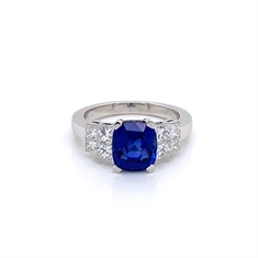 Sapphire Cushion Cut Engagement Ring With Princess Cut Diamond Shoulders