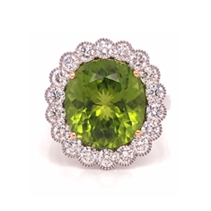 Oval Peridot & Brilliant Cut Diamond Cluster Ring With Migraine Detailing