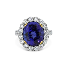 Tanzanite Oval & Brilliant Cut Diamond Cluster Ring With Diamond Set Shoulders