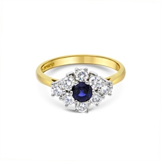 Round Sapphire & Brilliant Cut Diamond Cluster Ring