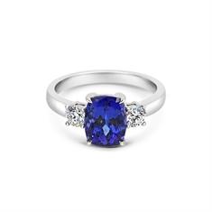 Oval Tanzanite & Brilliant Cut Diamond Three Stone Ring