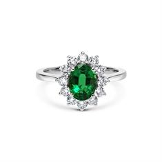 Emerald Oval & Brilliant Cut Diamond Cluster Ring
