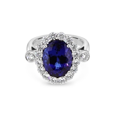 Oval Tanzanite & Brilliant Cut Diamond Cluster Ring With Rub-over Shoulders