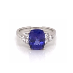 Cushion Cut Oval Tanzanite Dress Ring With Trefoil Diamond Set Shoulders