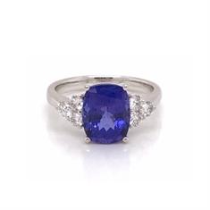 Cushion Cut Oval Tanzanite Dress Ring With Trefoil Diamond Set Shoulders